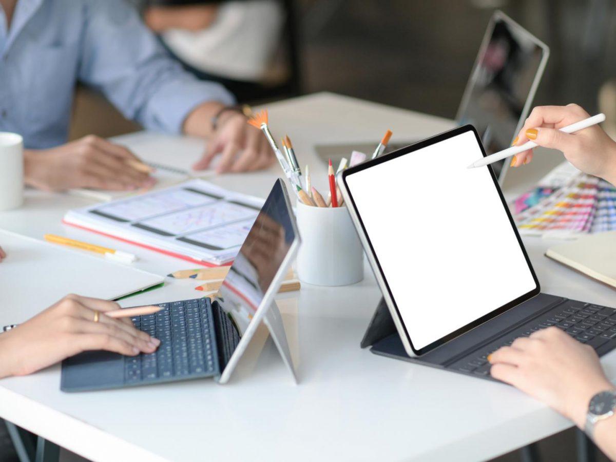 graphic-designer-team-uses-laptops-to-design-new-p-MDLGTMC